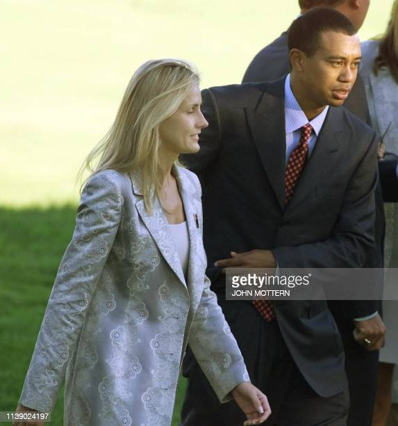 Us Ryder Cup team member Tiger Woods walks with his girlfriend Joanna Jagoda 23 September 1999 after opening ceremonies at The Country Club in...