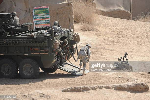Us soldiers deploy an explosives ordinance disposal robot during the joint IndiaUS Yudh Abhyas 2012 military exercise at Mahajan in Rajasthan sector...
