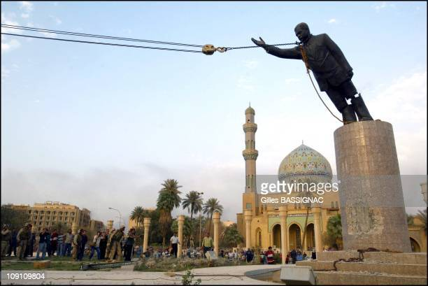 Operation Iraqi Freedom Day 21 Us Troops Enter Central Baghdad And Topple Statue Of Saddam Hussein On April 9 2003 In Baghdad Iraq Liberated By US...