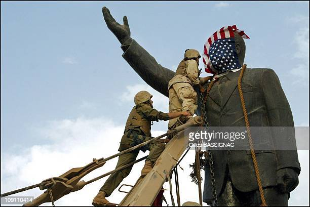 Operation Iraqi Freedom Day 21 Us Troops Enter Central Baghdad And Topple Statue Of Saddam Hussein On April 9 2003 In Baghdad Iraq Members Of The Us...