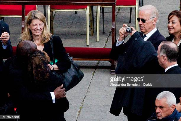 Us Vice President Joe Biden takes a photograph of his sister Valerie Biden Owens with a fellow delegate as they leave the Inauguration Mass for Pope...