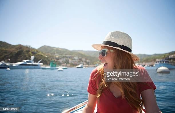 usa, california, catalina island, portrait of young woman in sunglasses and straw hat - catalina island stock photos and pictures