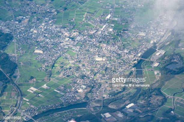 Usa city in Oita prefecture in Japan daytime aerial view from airplane