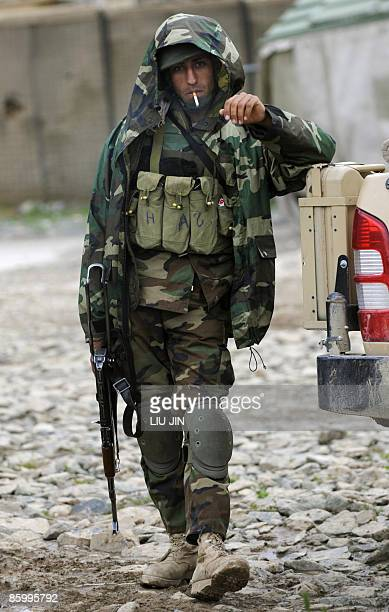 Afghanistan-unrest-military-security, FOCUS by Charlotte McDonald-Gibson An Afghan National Army soldier smokes at the ISAF's Camp Bostick in Naray...