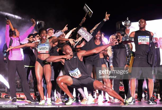 Usain Bolt and Asafa Powell of Usain Bolt's AllStar team and their teammates celebrate on stage with the trophy after winning the event during the...