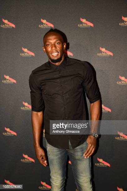Usain Bolt and ESA Astronaut Jean Francois Clervoy celebrate the launch of Unprecedented Gravity Bottle at Caveau Lalou on September 12, 2018 in...