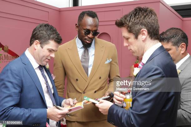 Usain Bolt and guest attend the Mumm marquee on Oaks Day at Flemington Racecourse on November 07 2019 in Melbourne Australia