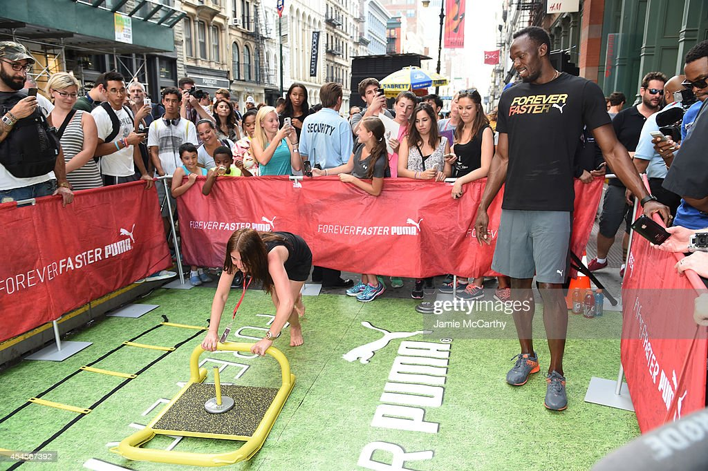 Usain Bolt and guest attend The PUMA Store Soho Training Event on ... 5491fc7789cb