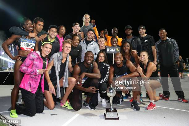 Usain Bolt and Usain Bolt's AllStar team celebrate with the trophy after winning the event during the Melbourne Nitro Athletics Series at Lakeside...