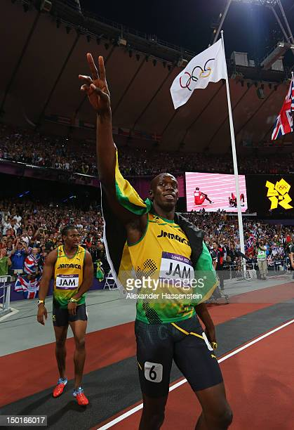 Usain Bolt and Yohan Blake of Jamaica celebrate after winning gold and setting a new world record of 36.84 during the Men's 4 x 100m Relay Final on...