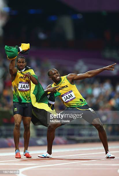 Usain Bolt and Yohan Blake of Jamaica celebrate winning gold and setting a new world record of 3684 during the Men's 4 x 100m Relay Final on Day 15...