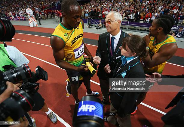 Usain Bolt and Yohan Blake of Jamaica speak to officials after the Men's 4 x 100m Relay Final on Day 15 of the London 2012 Olympic Games at Olympic...