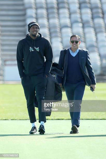 Usain Bolt arrives with manager Ricky Sims and Mariners CEO Shaun Mielekamp during Usain Bolt's first training session with the Central Coast...