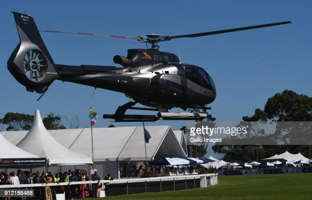 Usain Bolt arrives in a helicopter during the 2018 Sun Met at Kenilworth Racecourse on January 27 2018 in Cape Town South Africa The 134th edition of...