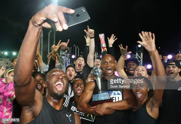 Usain Bolt Asafa Powell and Usain Bolt's AllStar team celebrate with the trophy after winning the event during the Melbourne Nitro Athletics Series...