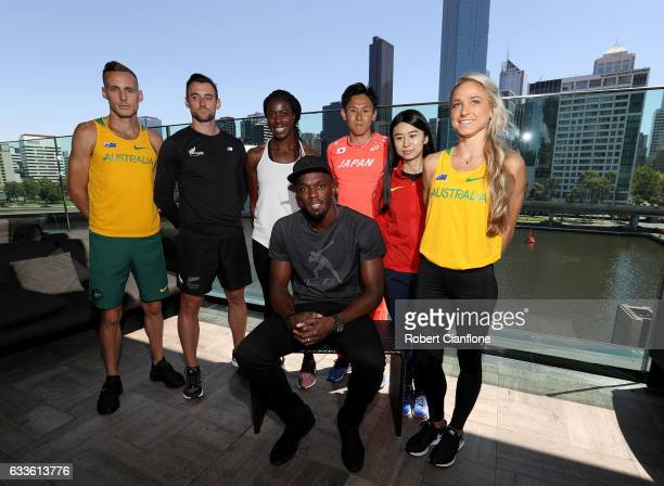 Usain Bolt captain of the Bolt AllStars poses with the Nitro Athletics Melbourne World Cup and Ryan Gregson of Australia Matthew Wyatt of New Zealand...