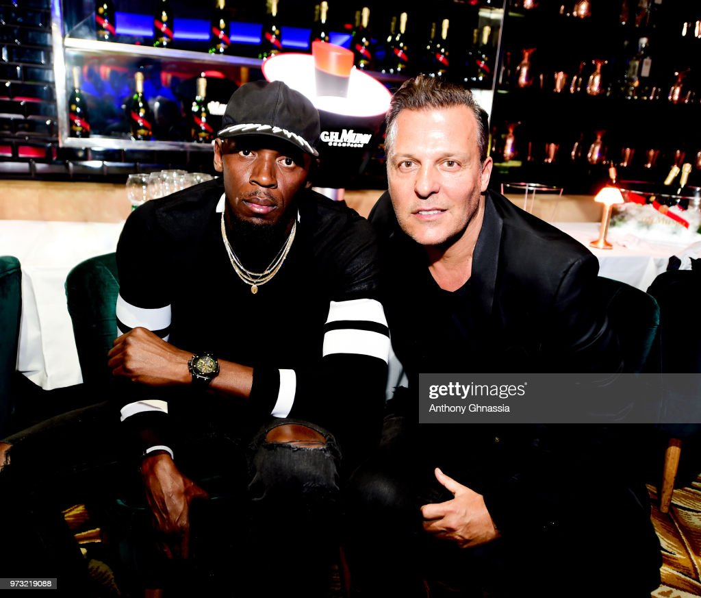 OUT] Usain Bolt, Chief Entertainment Officer of Mumm champagne and Jean Roch, head of Vip Room, celebrate a charity football game between France 98 and the best international players of FIFA 98 at VIP ROOM club, Paris on June 12, 2018 in Paris, France.