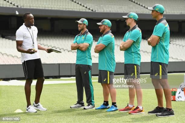Usain Bolt coaches Australian cricketers Glenn Maxwell Ashton Agar Peter Handscomb and Aaron Finch during the Gatorade Fastest Run at the Melbourne...