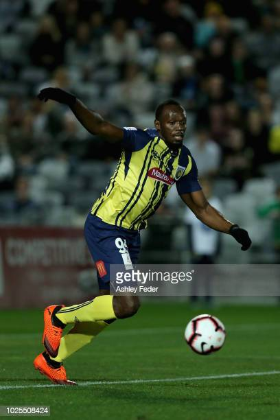 Usain Bolt controls the ball during the preseason match between the Central Coast Mariners and Central Coast Football at Central Coast Stadium on...