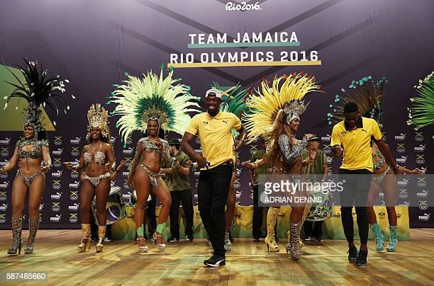 Usain Bolt dances samba during a Jamaican Olympic Association and Puma press conference at the Cidade Das Artes in Rio de Janeiro on August 8 2016 /...
