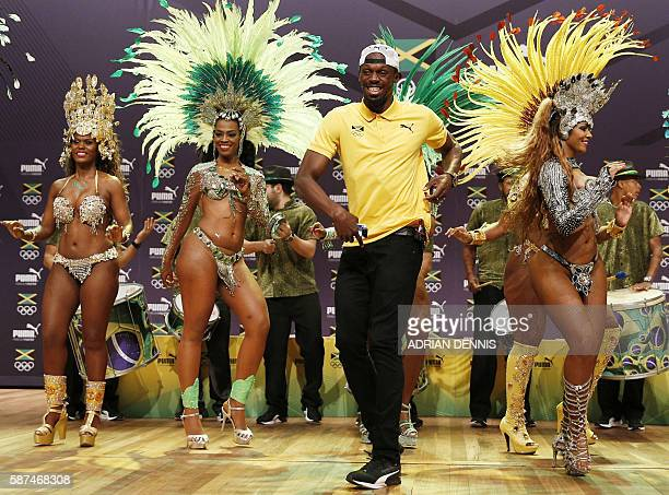 TOPSHOT Usain Bolt dances samba during a Jamaican Olympic Association and Puma press conference at the Cidade Das Artes in Rio de Janeiro on August 8...