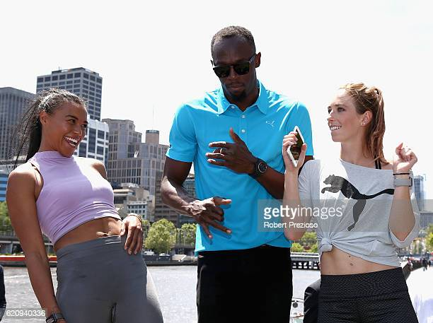 Usain Bolt dances with Australian Olympians Morgan Mitchell and Anneliese Rubie during the launch of Nitro Athletics on November 4 2016 in Melbourne...
