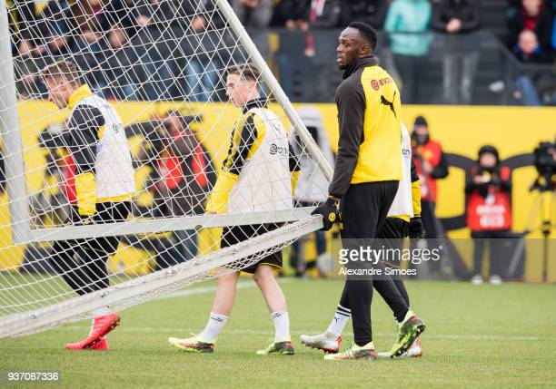 Usain Bolt in action during Borussia Dortmund's training session at the training ground on March 23 2018 in Dortmund Germany