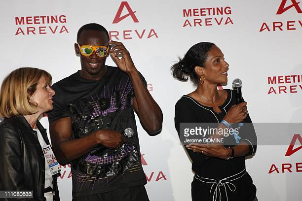 Usain Bolt in Paris France on July 16th 2010 Areva Meeting at the Stade de France in the evening Anne Lauvergeon Usain Bolt and Christine Arron