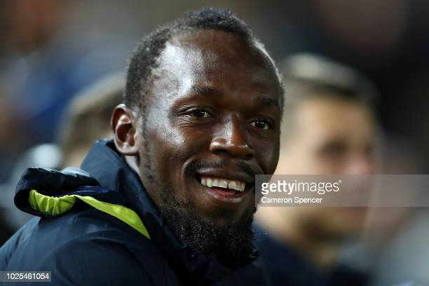 Usain Bolt looks on from the bench during the preseason match between the Central Coast Mariners and Central Coast Football at Central Coast Stadium...