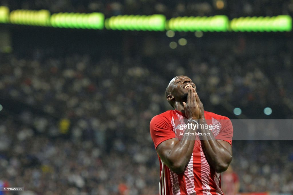 Usain Bolt of FIFA 98 reacts during the friendly match between France 98 and FIFA 98 at U Arena on June 12, 2018 in Nanterre, France.