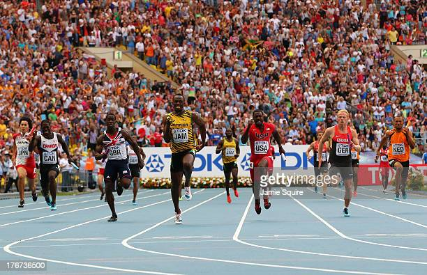 Usain Bolt of Jamaica 9C crosses the line first to won gold ahead of second place Justin Gatlin of the United States and third place Dwain Chambers...