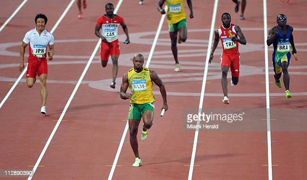 Usain Bolt of Jamaica anchors the 4x100meter relay team to gold on Friday August 22 in the Games of the XXIX Olympiad in Beijing China