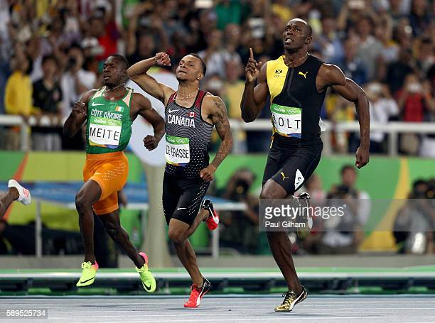Usain Bolt of Jamaica and Andre De Grasse of Canada compete in the Men's 100 meter final on Day 9 of the Rio 2016 Olympic Games at the Olympic...