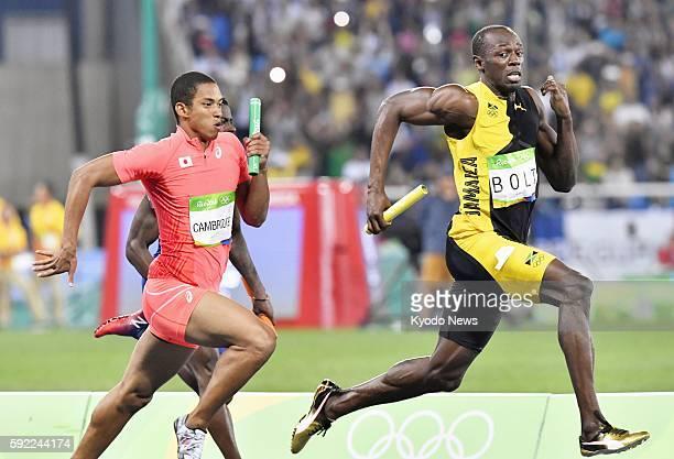Usain Bolt of Jamaica and Asuka Cambridge of Japan run during the men's 4x100meter relay final at the Rio de Janeiro Olympics on Aug 19 2016 Jamaica...