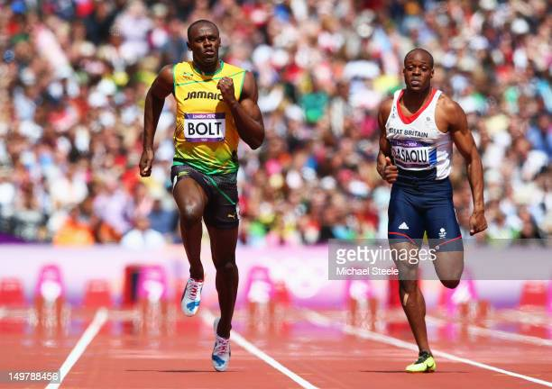 Usain Bolt of Jamaica and James Dasaolu of Great Britain compete in the Men's 100m Round 1 Heats on Day 8 of the London 2012 Olympic Games at Olympic...