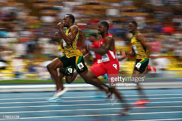 Usain Bolt of Jamaica and Justin Gatlin of the United States compete in the Men's 100 metres Final during Day Two of the 14th IAAF World Athletics...
