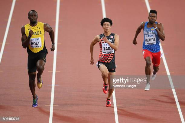 Usain Bolt of Jamaica and Shuhei Tada of Japan lead the race in the Men's 100 metres heats during day one of the 16th IAAF World Athletics...