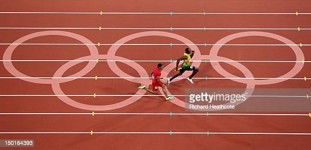 Usain Bolt of Jamaica approaches the finish line ahead of Ryan Bailey of the United States on his way to winning gold and setting a new world record...