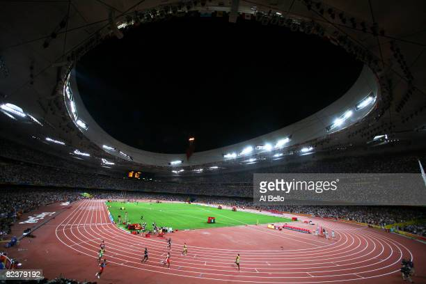 Usain Bolt of Jamaica begins a lap of honour after winning the Men's 100m Final at the National Stadium on Day 8 of the Beijing 2008 Olympic Games on...