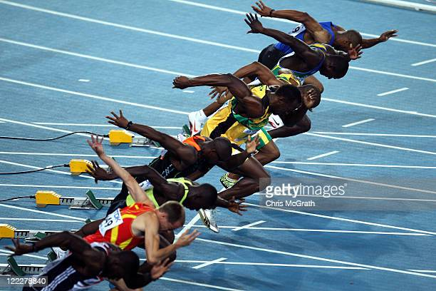 Usain Bolt of Jamaica bursts out of the blocks with the other competitors at the start of the men's 100 metres heats during day one of the 13th IAAF...