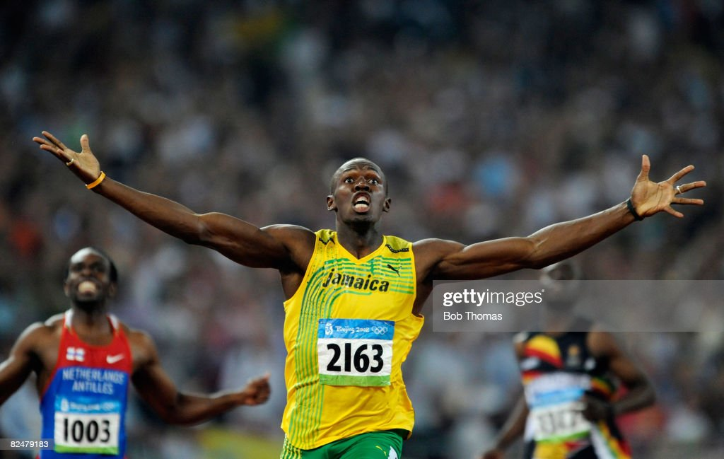 Usain Bolt of Jamaica celebrates after breaking the world record with a time of 19.30 seconds to win the gold medal in the Men's 200m Final at the National Stadium during Day 12 of the Beijing 2008 Olympic Games on August 20, 2008 in Beijing, China.