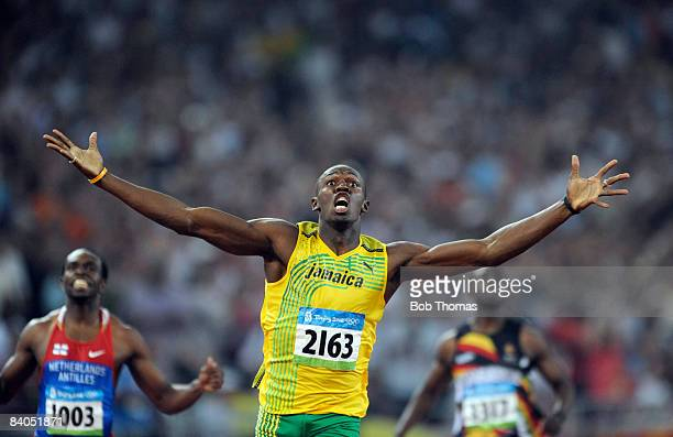 Usain Bolt of Jamaica celebrates after breaking the world record with a time of 1930 seconds to win the gold medal in the Men's 200m Final at the...