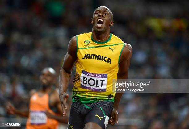Usain Bolt of Jamaica celebrates after crossing the finish line to win the gold medal in the Men's 100m Final on Day 9 of the London 2012 Olympic...