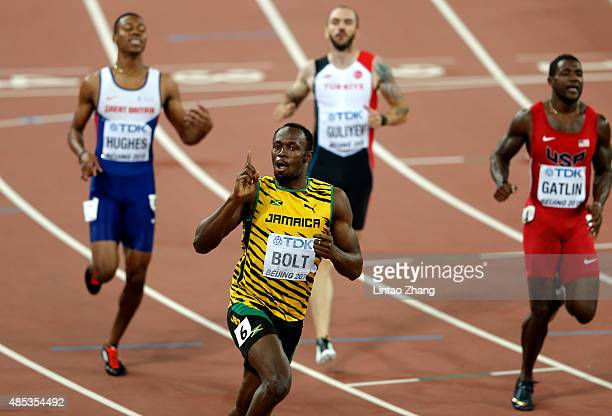 Usain Bolt of Jamaica celebrates after crossing the finish line to win gold in the Men's 200 metres final during day six of the 15th IAAF World...