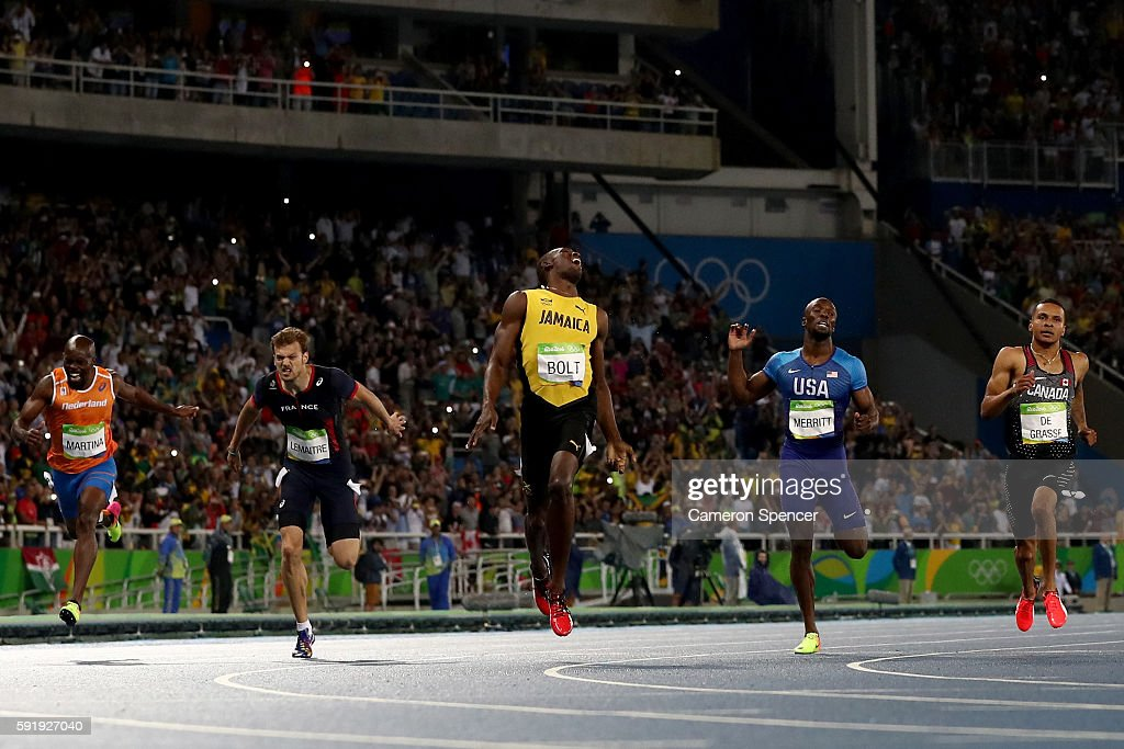 Usain Bolt of Jamaica celebrates after crossing the finish line to win the Mens 200m final on Day 13 of the Rio 2016 Olympic Games at the Olympic Stadium on August 18, 2016 in Rio de Janeiro, Brazil.