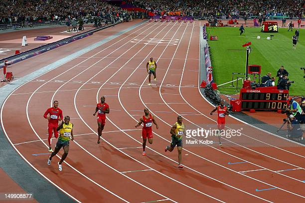 Usain Bolt of Jamaica celebrates after his win gold in the Men's 100m Final on Day 9 of the London 2012 Olympic Games at the Olympic Stadiumat...