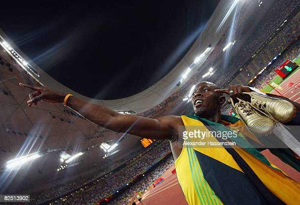 Usain Bolt of Jamaica celebrates after running the final leg in the Men's 4 x 100m Relay Final at the National Stadium on Day 14 of the Beijing 2008...