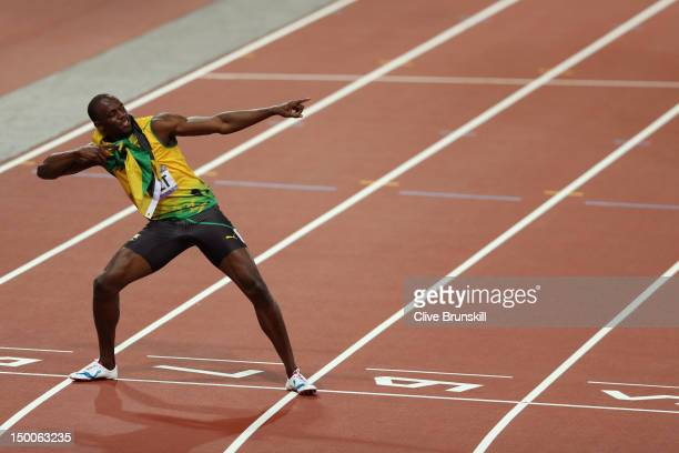 Usain Bolt of Jamaica celebrates after winning gold in the Men's 200m Final on Day 13 of the London 2012 Olympic Games at Olympic Stadium on August...