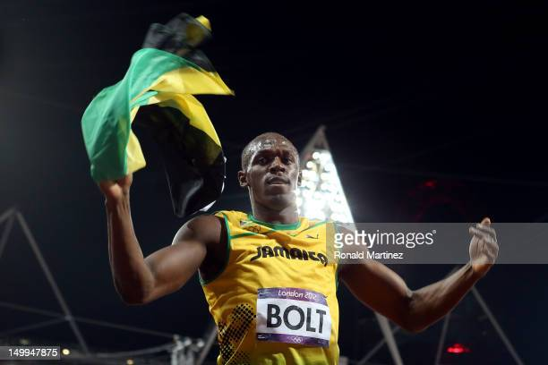 Usain Bolt of Jamaica celebrates after winning the gold medal in the Men's 100m Final on Day 9 of the London 2012 Olympic Games at the Olympic...