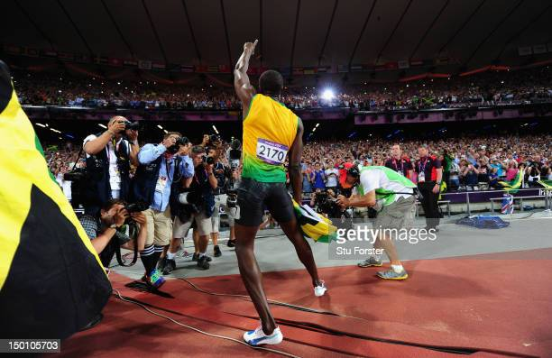Usain Bolt of Jamaica celebrates after winning the Mens 200 metres on Day 13 of the London 2012 Olympic Games at Olympic Stadium on August 9 2012 in...
